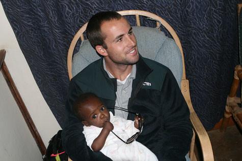 Jason Holding a Baby