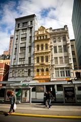 Stepping Out (Mark Broadhead) Tags: street architecture tracks tram australia melbourne pedestrian victoria lookingup stop shelter elizabethstreet smokemart