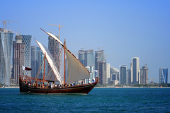 Holding On To Our Roots (Orangeya) Tags: ocean new old blue sea building skyline vintage landscape boat day flag 18th dec national doha qatar cornish blueish qatari   orangeya  0rangeya