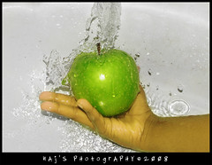 Drizzle (Naj ) Tags: green apple water fruit canon flow 1 experiments clean explore wash 200 splash greenapple naj drizzling nazy najy sx110 inspiks|inspirationalpictures najsphotography
