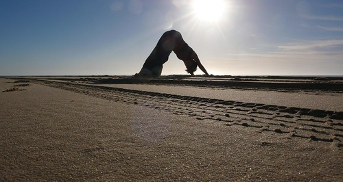 downward dog on the beach in the AM