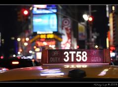 Times Square Yellow Cab (Natasja ) Tags: yellowcab taxy color colorful cab closeup bokeh dof new york city usa america manhattan newyork newyorkcity december winter ny nyc thebigapple canon 40d eos 40d times square crossroad times square night night photography neon lights street