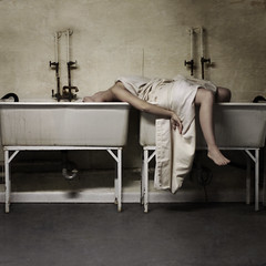 water fountain (brookeshaden) Tags: woman selfportrait water dark table foot death rust shadows sink antique pipes tubes basement machine wash morbid rest sheet drips cracks waterfountain sinks hoses limp whitesheet nikond80 masterpiecesoflightdark