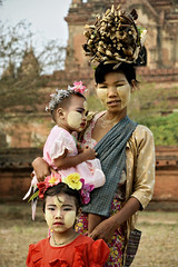 Young woman with wood on her head and thanaka face paint with her daughters in Bagan - Myanmar (PascalBo) Tags: portrait people woman baby girl childhood mom outdoors kid nikon asia southeastasia child d70 burma femme mother mum myanmar asie maman motherhood enfant fille bébé carrying pagan bagan thanaka mère birmanie 123faves asiedusudest pascalboegli