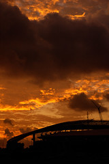 Terengganu Stadium (SUKMA XII 2008, Terengganu) (Fadzly @ Shutterhack) Tags: city travel light shadow sky orange cloud hot building sports nature silhouette yellow sunrise d50 dark landscape asian golden interestingness nikon asia stadium natureza low natur natura hour malaysia tropical vista tropic kuala olympic olympics nikkor scape paysage  50mmf18d 2008 xii asean  terengganu equator humid landschap mys unprocessed sukan   maleisi charakter  sukma explored  olimpik sooc nikonstunninggallery kalikasan shutterhack afsnikkor50mmf18dc sultanmizanstadium tsunamiinthesky