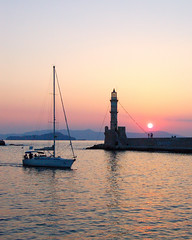 Venetian lighthouse of Chania on the Greek island of Crete (Peace Correspondent) Tags: sunset sun lighthouse tower architecture marina d50 harbor boat ancient marine europe mediterranean stonework ships eu vessel creta greece crete hania sail venetian sailboats xania southerneurope chania greekisland ancientarchitecture 5photosaday seaofcrete venetianharbor venetianlighthouse chanialighthouse cretansea hanialighthouse xanialighthouse