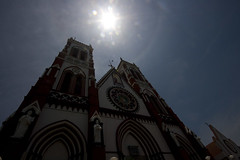 sacred heart (vbsuresh) Tags: blue light sky brown sun sunlight india white building church cross jesus sunday statues arches flare devotees prayers pondicherry sacredheartchurch