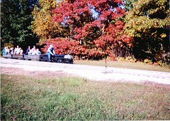 Miniature live steam New York Central RR J-1E class 4-6-4 Hudson and train passing through Autum colors. The Hesston Steam Museum. Hesston Indiana USA. October 1998.