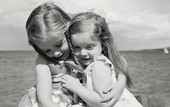 Sisterly Love (nico fell photography) Tags: girls love film sisters nikon hug grain cuddle f301 1000thphotoonflickr