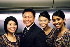Singapore Airlines SQ1 Cabin Crew (Premshree Pillai) Tags: travel portrait people film smile asian hongkong inflight women singapore fuji aircraft aviation bodylanguage explore crew airline fujifilm boeing stewardess sq f5 hkg 747 sia onboard b747 steward singaporeairlines singaporeans sq1 fujicolor nikonf5 airhostess singaporegirl hkia singaporegirls b47 fujicolorpro160c sfohkg sfohkgsin hkgsin singaporesep08