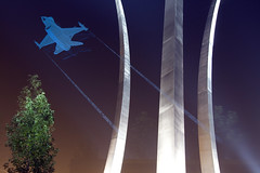 F-16 on etched glass (Rozanne Hakala) Tags: sky etched usa reflection glass night arlington virginia three flying dc washington memorial fighter force martin dusk spires steel air flight jet f16 remembrance lockheed skyward usaf graceful stainless soar usairforce airmen