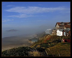 Mist and Sea (Tony Fischer Photography) Tags: ocean sea sky orange usa mist green beach fog clouds oregon coast us unitedstates hill ridge coastal newport shore fabulous rim smrgsbord blus blueribbonwinner