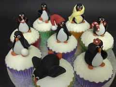Penguin cupcakes (SmallThingsIced) Tags: christmas party children penguins cupcakes hats presents scarves toppers embossed