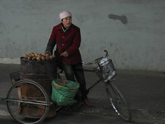 Yams for sale (spartrek4635) Tags: potatoes sweet beijing yams vendor