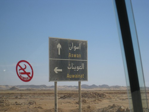 Sign for Aswan amidst the desert terrain