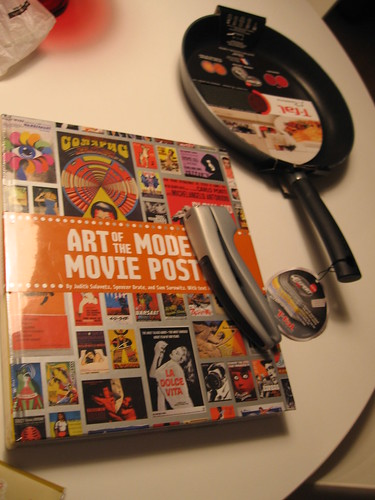 Frying pan from mom, garlic press from dad and movie poster book from bro