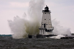 Big Water - Ludington North Breakwater Light (James Marvin Phelps) Tags: winter lighthouse cold ice outdoors photography michigan great lakes lakemichigan jmp crashingwaves ludingtonmichigan mandj98 jamesmarvinphelps ludingtonnorthbreakwaterlight