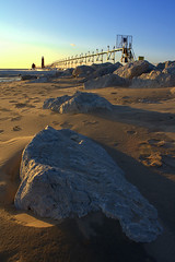 Stoney waters (Second Glance Photos Kevin Ryan) Tags: park winter sunset lighthouse snow haven beach water rock canon landscape eos rebel pier sand state michigan south grand boulder xs catwalk pierhead