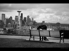I. C U D D L E . I N . S E A T T L E .I (donpar) Tags: seattle white black love grass clouds canon buildings bench blackwhite bush downtown affection space rail overcast center needle cuddle supershot diamondclassphotographer donpar