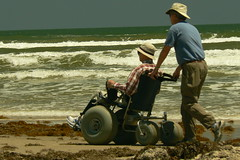 Beach wheelchair (qnr) Tags: people beach wheelchair padreislandnationalseashore corpuschristitexas panasonicdmcfz7 malaquite 10millionphotos