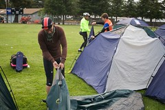 Lance breaks down his tent.
