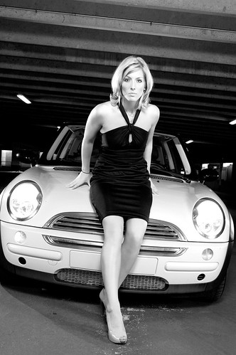 Cliché photo of a girl and a car, in black and white