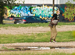 Walking by Graffiti (Bill Oriani) Tags: woman austin walking graffiti bill texas 2008 eastaustin oriani 50200mmf2835 billoriani
