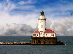 Chicago Harbor Lighthouse (Storm Crypt) Tags: city roof light red lighthouse lake chicago tower water rock clouds concrete harbor illinois iron harbour steel horizon cement lakemichigan greatlakes metropolis visual redlight lighttower freshwater redroof freshwaterlake chicagoharbor cityofchicago cityharbor mywinners cityharbour redbeam centralus chicagoharbour visualguidance