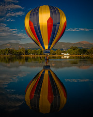"Colorado Balloon Classic - ""Day 1"" (iceman9294) Tags: blue red sky hot color reflection festival balloons bravo colorado air hotair balloon professional coloradosprings hotairballoon hotairballoons ballooning memorialpark balloonfest coloradoballoonclassic prospectlake abigfave bestofmywinners"