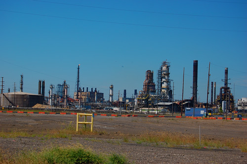 out by the gas fires of the refinery via Flickr