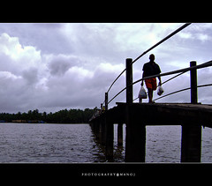 Balancing life! (Manoj Aswathi's Travel& Photography.) Tags: travel bridge tourism kerala keralam riverbridge malabar crossingriver kasargode kanhangad aswathi233 mtv233 neeleswaram manonbridge photographymanoj manojphotography kottappuram manwithlungi traditionalkeraladress