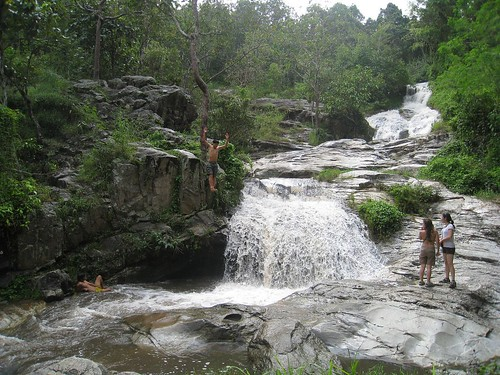 A local jumps off a cliff at a waterfall near Chiang Mai