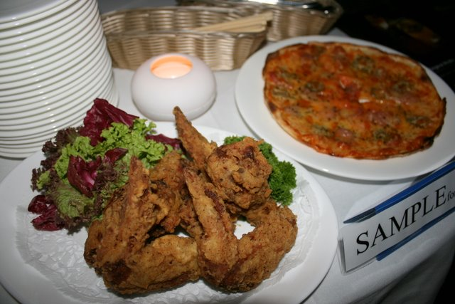 Deep-fried chicken wings and pizza from Cable Car