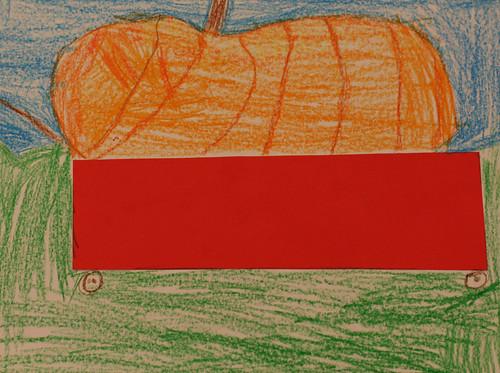 Hailey's pumpkin in a wagon