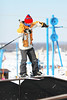 A skier performs a trick on a rail in the terrain park at Timber Ridge Ski Area, Michigan