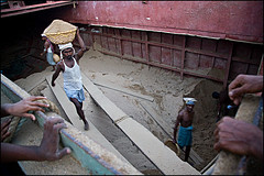 sand - Chittagong (Maciej Dakowicz) Tags: city people work river boat sand asia ship bangladesh carry sadarghat unload chittagong
