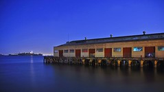 across from alcatraz 3 (pbo31) Tags: sf sanfrancisco california above city longexposure blue sky urban orange usa brown lighthouse black color water architecture night america port buildings dark bay march pier spring lowlight nikon marine noir view darkness purple image fort over structure latenight sanfranciscobayarea sail alcatraz sanfranciscobay fortmason bluehour d200 2008 westcoast beacon sanfranciscocounty longexposue urbanarea