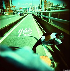 I enjoy speed !! (Twiggy Tu) Tags: selfportrait 120 film brad lomo taipei twiggy holga120n listeningtoipod whiteholga aplusphoto lomopeoplelomolife athighspeed ilikerockrollimarocker