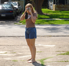 Meta photography (colorblindPICASO) Tags: road street camera sun sarah outside texas legs sunny driveway blond barefoot barefeet shorts frontyard ona teeshirt bellaire oldcamera nomakeup descalzo jeanshorts withoutmakeup brightsun inthesun barfuss allnatural denimshorts hairinthewind retrocamera sinzapatos crackedconcrete apiedinudinelparco brownteeshirt barfus grassinthesidewalk