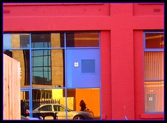 Ms Mondrian  Reflecta (indigo_girl) Tags: windows red orange woman reflection me dutch car cyclist indigo snapper brickwork bycycle pietmondrian