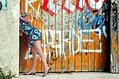curiosity (mypixbox) Tags: door wood blue red orange woman girl fun pretty mare legs hangar porta acapulco palermo sicilia gambe graffits capannone img2896 addaura colourartaward silviaziloveu