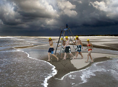 carrying a stance (panta rhei.) Tags: sea sky beach water kids youth clouds dark island stand explore northsea teenager ostfriesland bathing nordsee carrying stance bathingcaps baltrum notafraid inselbaltrum waterrescuekids