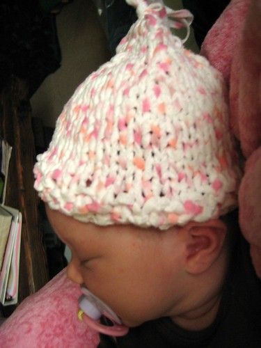 Baby Rose sleeping in her hat