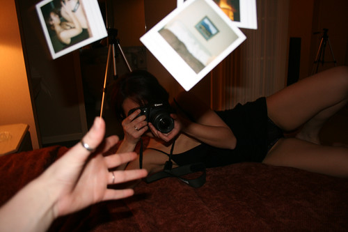 Tossed polaroids and Carmen in her underwear.