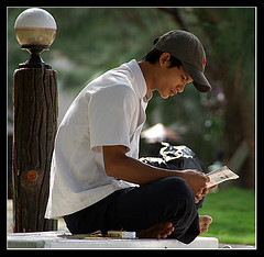 Vietnamese man reading (Jom Manilat) Tags: man island reading vietnam phuquoc aficionados