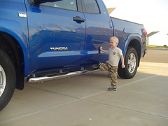 Jackson checking out the new Nasta step bars on dad's Tundra.