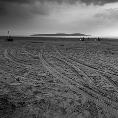 Weston Beach (Adam Clutterbuck) Tags: uk greatbritain england blackandwhite bw seascape beach monochrome clouds square landscape mono coast blackwhite cloudy unitedkingdom britain tracks footprints cleanup somerset down bn severn coastal shore elements esplanade promenade gb seafront bandw sq oe tyre westonsupermare weston breandown brean greengage adamclutterbuck sqbw bwsq showinrecentset openedition