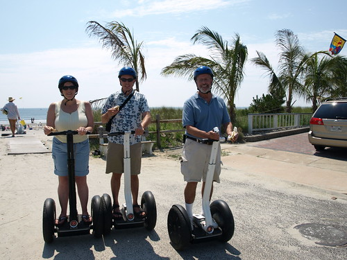 Riding a Segway with a Sabrett in hand...
