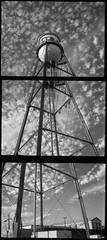 Water Tower Multiple (efo) Tags: bw panorama clouds berkeley multiple watertank fomapan200 olympuspens penograph