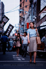 Lady walking in Tsukiji (Alfie | Japanorama) Tags: street woman fish girl japan lady japanese tokyo nikon market candid tsukiji d300 nikkor85mmf14afd